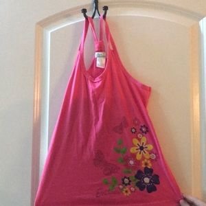 A pink tank top with flowers and butterflies